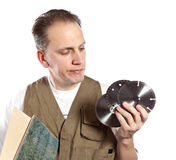 The man in working overalls and disk for the tool .Portrait on a white background Royalty Free Stock Image