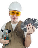 The man in working overalls in goggles and a helmet with the detachable machine and saw disks.Portrait on a white background Stock Image