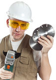 The man in working overalls in goggles and a helmet.Portrait on a white background Royalty Free Stock Photos