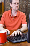 Man working on PC Royalty Free Stock Image