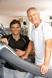 Man Working With Personal Trainer stock images