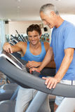 Man Working With Personal Trainer stock photography