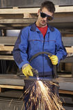 Man working with plasma cutter. On steel plate at industrial workshop stock images