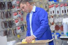 Man working in plumbers merchants Royalty Free Stock Photos