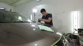 Worker polishing the car with power buffer machine stock video