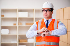 The man working in postal parcel delivery service office Stock Images