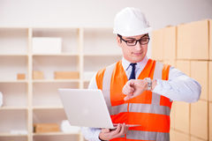 The man working in postal parcel delivery service office Stock Image