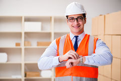 The man working in postal parcel delivery service office Royalty Free Stock Photography