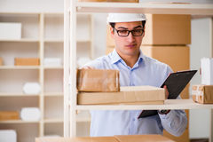 The man working in postal parcel delivery service office Stock Photography