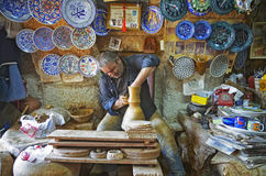 Man working on the potter`s wheel Stock Photos