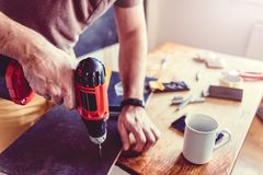 Man working with power drill royalty free stock image