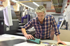 Man working in printing industry Stock Photos
