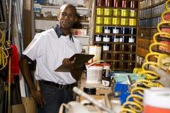 Man working in printshop Stock Images