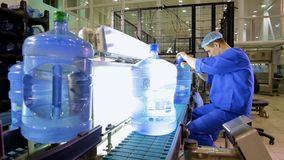 Man working on the production of clean water and inspection bottles for cracks stock video