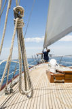 Man working on prow of yacht Royalty Free Stock Images