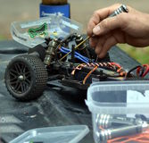 Man working on the radio controlled buggy car model Stock Image