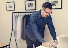 Man working in retail cloth shop royalty free stock photos