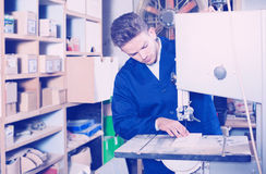 Man working with ribbon saw Stock Images