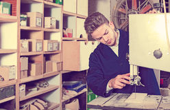 Man working with ribbon saw Royalty Free Stock Photo