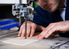 Man working with ribbon saw Royalty Free Stock Photography