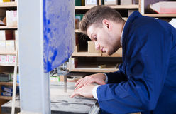Man working with ribbon saw Stock Photography