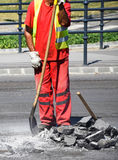 Man is working at the road construction Stock Image
