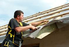Man working on roof Stock Photos