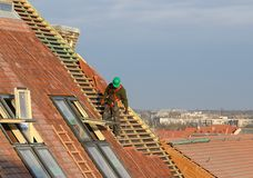 Man working on the roof Stock Image