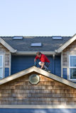 Man Working on a Roof - Vertical Stock Image