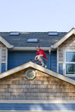 Man Working on a Roof - Vertical Royalty Free Stock Photos