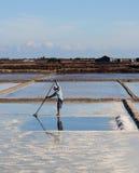 A man working on the salt field in Hon Khoi, Vietnam Stock Photo