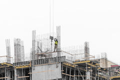 Man working on scaffold. Man worker working on scaffold on cold Royalty Free Stock Photography