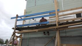 Man working on scaffolding