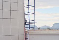 Man working on scaffolding. Ma working on scaffolding on a modern building in africa Royalty Free Stock Images