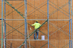 Man working on scaffolding. Stock Images
