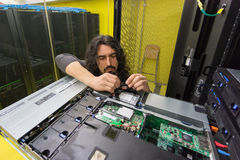 Man working with server in data center Stock Image
