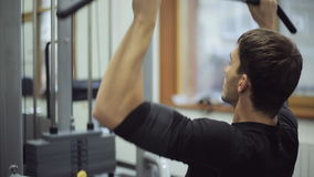 Man working on simulator thrust of upper block in gym. stock footage