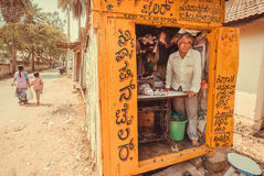 Man working in small tailor store on street of indian city Royalty Free Stock Photo