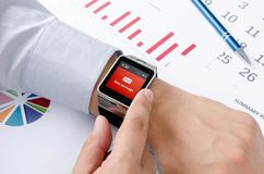 Man working with smart watch in office Royalty Free Stock Images