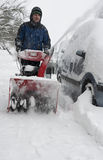 Man working with a snow blowing machine Stock Images