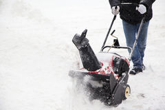 Man working with a snow blowing machine Royalty Free Stock Image