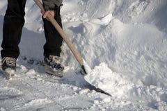 Man working with snow shovel Stock Photos