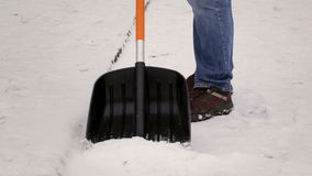 Man working with snow shovel stock video footage