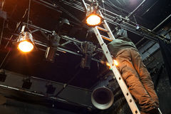 Man working on Stage Lighting.  royalty free stock photography