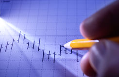 Man working on a statistical graph Stock Images