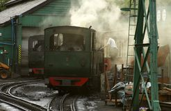 Man working on steam train Station stock photography