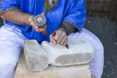 Man working stone and tools Stock Images