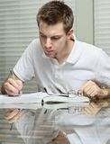 Man working and studying Royalty Free Stock Photos
