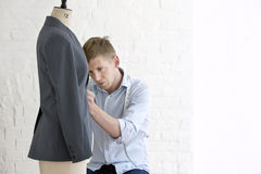 Man Working On Suit In Studio Royalty Free Stock Image