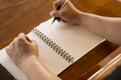 Man working table book pen booklet concept Royalty Free Stock Photos